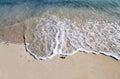 Wave on white sand Royalty Free Stock Photo