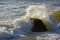 Waves splashing against a rock Royalty Free Stock Photo