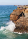 Waves break about rocks the atlantic ocean at coast of portugal Stock Photos