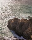 Waves breaking on a cliff in the pacific ocean   Big Sur  California Royalty Free Stock Photo