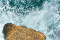 Waves breaking on rocky coast. Royalty Free Stock Photo