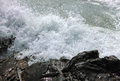 Waves breaking at rocky coast Royalty Free Stock Photo