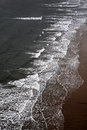 Waves breaking on a sandy beach Royalty Free Stock Photo
