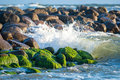 Waves breaking to stones Royalty Free Stock Photo