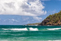 Waves coastline sunny hawaii blue sky aqua water and on a day at anini bay on the north shore of kauai just off hanapai beach Stock Image