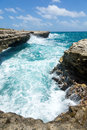 Waves crashing on the coastline devil s bridge antigua sunshine Royalty Free Stock Images