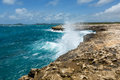 Waves crashing over coastline at devil s bridge antigua in sunshine Stock Image