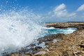 Waves crashing over devil s bridge coastline antigua in sunshine Royalty Free Stock Image
