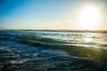 Waves crashing padre island beach gulf of mexico on a clear morning in corpus christi texas with the sun rising over the ocean at Royalty Free Stock Photo
