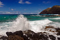 Waves crashing on rocks on the coast of Oahu, Hawaii Royalty Free Stock Photo