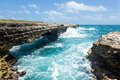 Waves crashing on rocks at devil s bridge antigua in sunshine Royalty Free Stock Photography