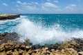 Waves crashing on rocky coastline devil s bridge antigua Stock Image