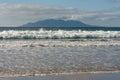 Waves crashing on sandy beach at Anchor Bay Royalty Free Stock Photo