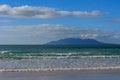 Waves crashing on sandy beach Royalty Free Stock Photo