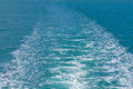 Waves of a ferry crossing the ocean Royalty Free Stock Photo