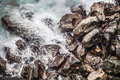 Waves Hitting Rocks During A S...