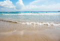 Waves lapping on the shore beach in sunny day Stock Photography