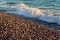 Waves at pebble beach sunset in abkhazia Royalty Free Stock Photo