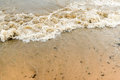 Waves on sandy beach Royalty Free Stock Photo
