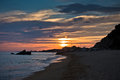 Waves on a sandy beach at sunset west coast of sithonia greece Stock Photos