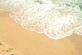 Waves of sea and yellow sand on beach natural background Royalty Free Stock Images
