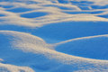 Waves of snow bumps macro shoot at sunrise Royalty Free Stock Images