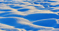 Waves of snow bumps macro shoot at sunrise Stock Image