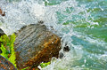 Waves splash on the large boulders on the beach Royalty Free Stock Photo