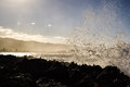 Waves splashing on rocks near haleiwa north shore oahu crashing at s coast the town of spray in the air the mountain range in the Royalty Free Stock Photos