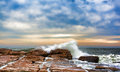Waves washing over rocks at southwest harbor maine rolling the Royalty Free Stock Photo