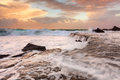 Waves waterfalls and sea foam ocean large fast flowing water lots of at a peachy sunrise morning forresters beach nsw australia Stock Images