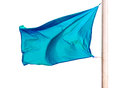 Waving blue flag isolated over white Royalty Free Stock Image