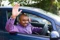 Waving goodbye man from his car Royalty Free Stock Images