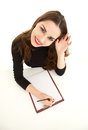 Waving hello young woman with clipboard Royalty Free Stock Photo