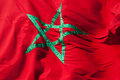 Waving national flag of morocco green star on red background Stock Image