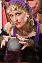 Waving over a crystal ball pretty lady hands Royalty Free Stock Image