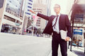 Waving for a taxi in city businessman trying to catch business cuty district Stock Photos