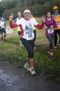 Waving woman in Marathon of the Epiphany, Rome, Italy Royalty Free Stock Photo