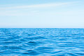 Wavy blue ocean with blue sky Royalty Free Stock Photo