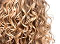 Wavy curly blonde hair closeup texture of permed Stock Image