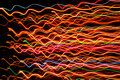 Wavy Multicolored Glowing Lines on Dark Background Royalty Free Stock Photo