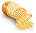 Wavy potato chips cut tubers converted into fries Stock Photo