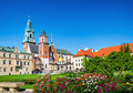 Wawel castle and cathedral square krakow poland with flowers in foreground in Stock Images