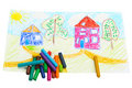 Wax crayons and a children's drawing. Stock Photos