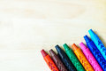 wax crayons on wooden background with copy space Royalty Free Stock Photo