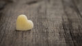 Wax heart a beige out of on wooden background Stock Images