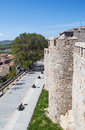 Way in avila view of a the spanish city of on one side you see the wall with towerand the other houses the city is a vertical Royalty Free Stock Photos