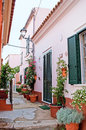 The way home la maddalena sardinia september scenic residential neighborhood narrow courtyards decorated with flowers in pots on Royalty Free Stock Photography