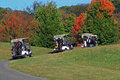 Way play golf drive carts on the to in beautiful autumn Royalty Free Stock Image