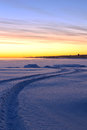 A way among the snow under colorful dawning sky